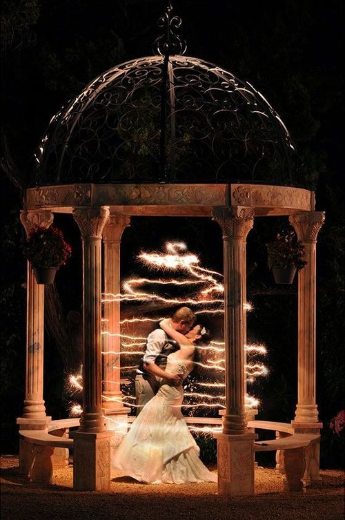 newlyweds kissing in light circles