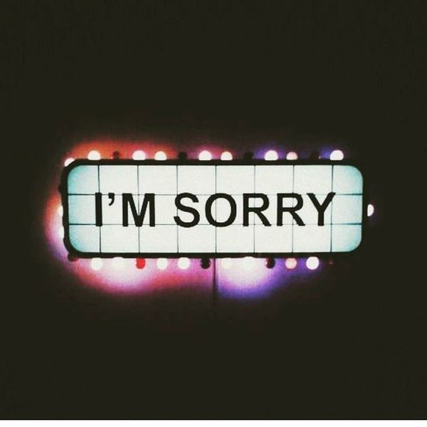 i am sorry neon text on poster